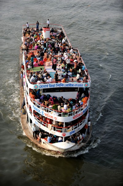 People risk over crowded passenger ships to reach home during Eid. Image by Maji, copyright Demotix (26/11/2009).