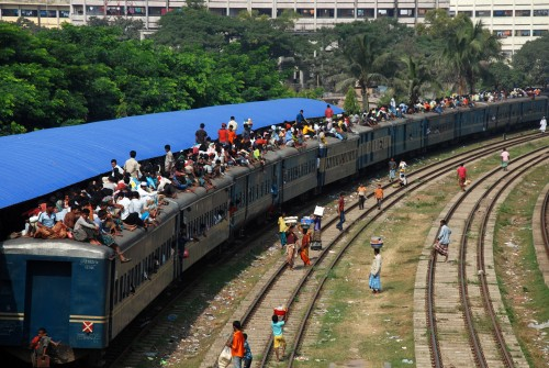 People gather at various train stations in Dhaka to leave the city to celebrate Eid with their friends and families. Image by Saad Shahriar, copyright Demotix (15/11/2010).