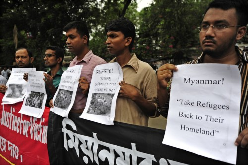 Members of the Protest Rohingya Initiative hold banners and images of those caught up in the violence. Image by Firoz Ahmed. Copyright Demotix.