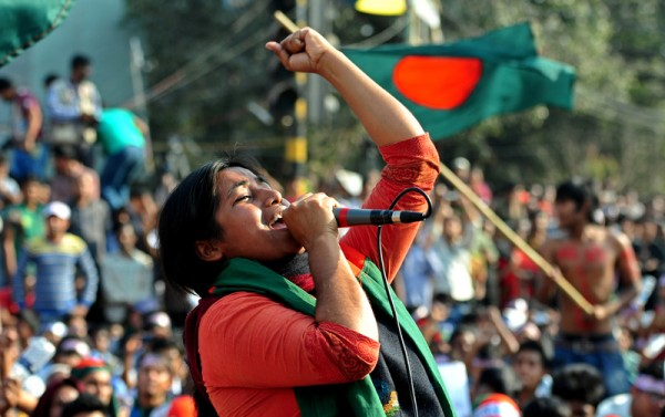 Students from different institutions join the protest demanding the death penalty for all war criminals at Shahbagh in the capital. In the Picture Lucky Akter shouting slogans. Image by Firoz Ahmed